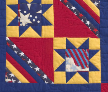Detail of a pattern with a wonderful focus fabric in the center of the star.  Patriotic Modern Book coming September 2017