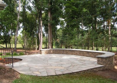 Slate Patio with Stacked Stone Wall