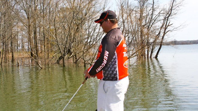 Bass pro Tim Grein tries to target shoreline gum trees and willow bushes when the water level rises a few feet above normal at Kerr Reservoir.