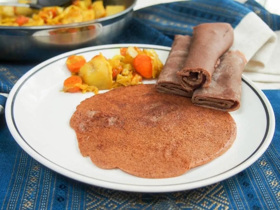 Ethiopian injera and tikel gomen