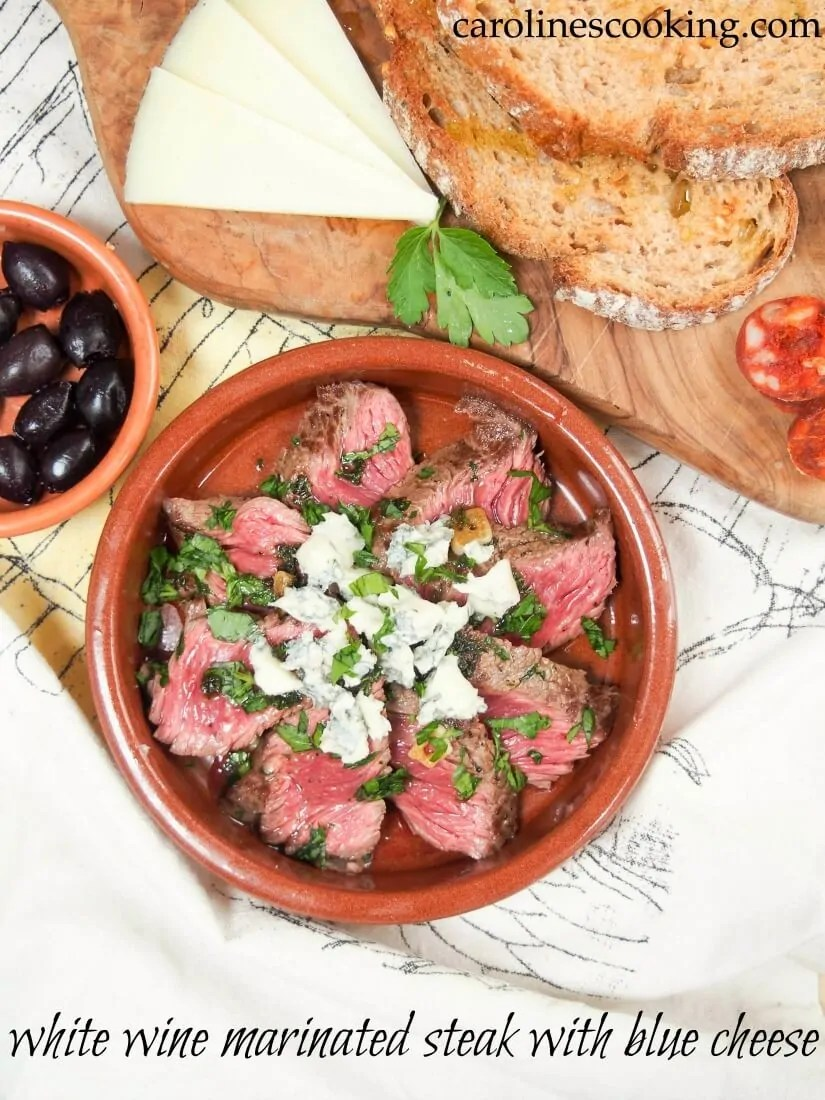 This white wine marinated steak with blue cheese is easy to make, full of flavor and makes a great tapas dish alongside your favorites or make it a main.