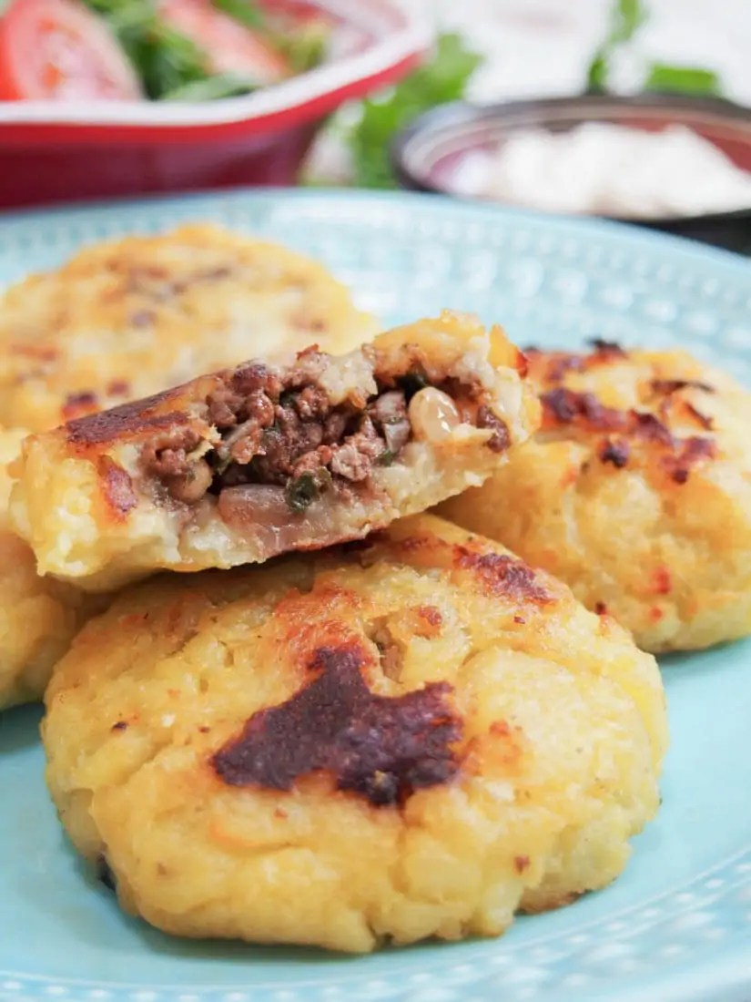 Persian lamb stuffed potato cakes - These Persian lamb stuffed potato cakes are a delicious combination of soft mashed potato around a spiced lamb filling. A great snack or part of mezze plate