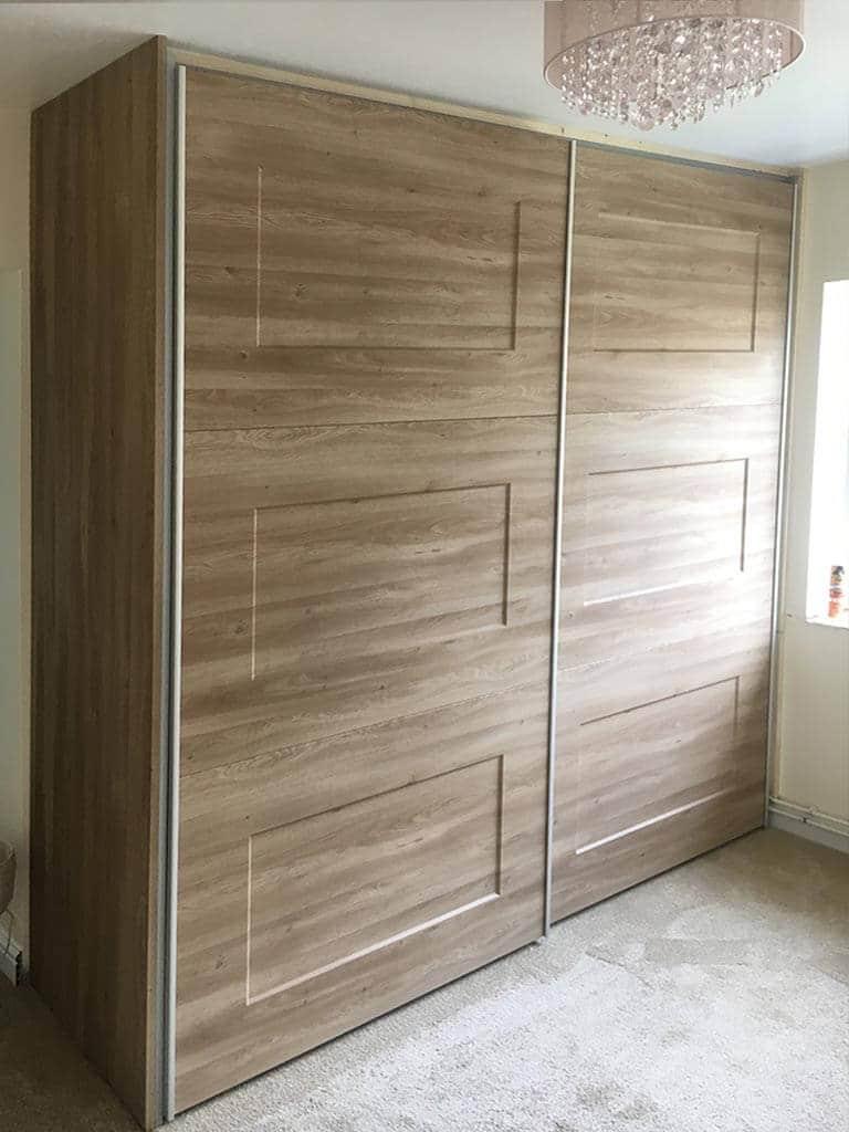 Oak effect sliding wardrobes closed
