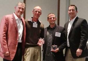 Ryan Dunn and Kevin Logue give award