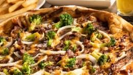 On déguste la nouvelle pizza Fondue Chinoise de Normandin