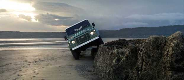Land Rover Defender on the beach at Red Wharf Bay, Anglesey