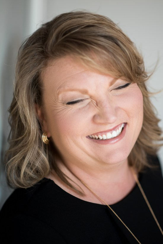 A natural and candid smile or laughing headshot of a brunette woman. Professional Portrait by Carrie Anne White Charlotte NC Photographer