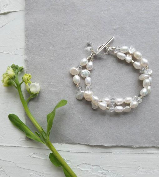 Double strand pearl and clear stone bridal bracelet handcrafted by Carrie Whelan Designs