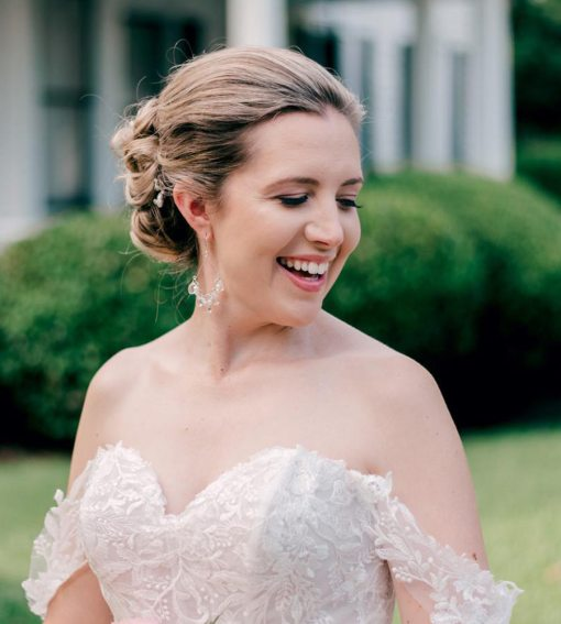 Bride in chandelier earrings made with silver and pearl by Carrie Whelan Designs
