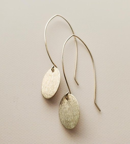 Long dangle brushed silver oval earrings handmade by Carrie Whelan Designs
