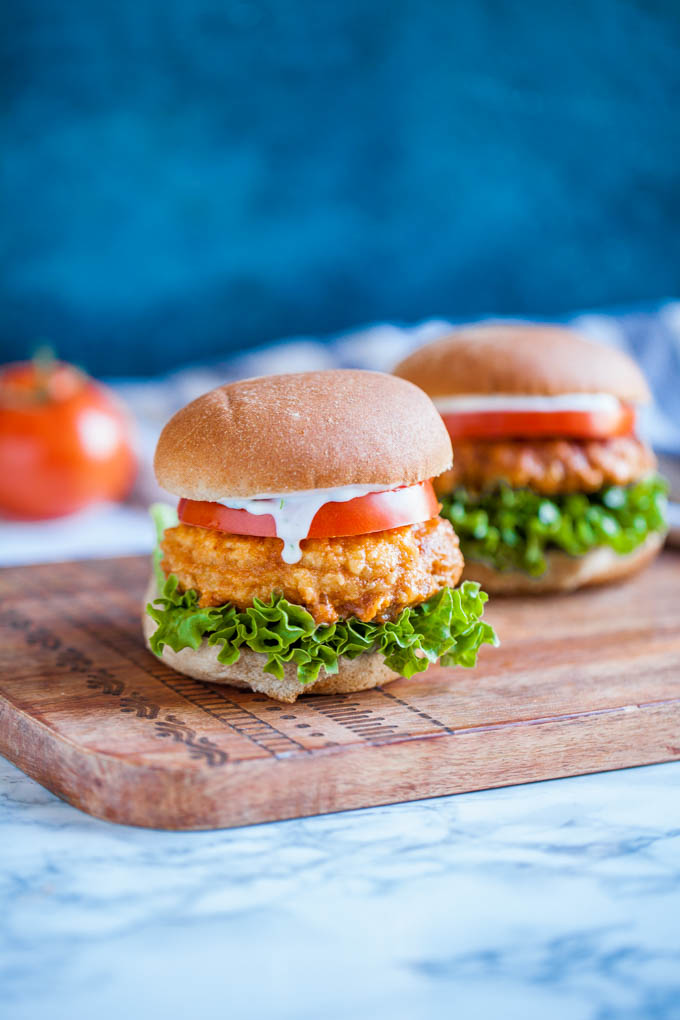 Buffalo Chickpea Sandwiches - vegan comfort food at it's finest! Simple ingredients + easy methods make this perfect for weeknight dinners