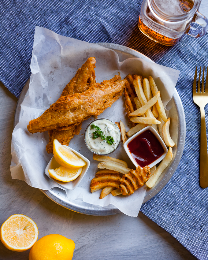 Perfectly golden and crisp Vegan Fish & Chips made with banana blossoms for the perfect texture. Vegan comfort food at it's finest! Perfect recipe for dinner or date night!