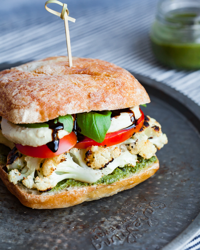Unbelievably flavorful + satisfying Vegan Caprese Sandwich | Made with cashew mozzarella + roasted cauliflower for heartiness + crunch | #vegan #vegancheese #plantbased #easy