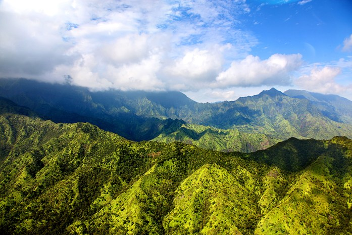 View of lush green mountains near Na Pali coast in Kauai