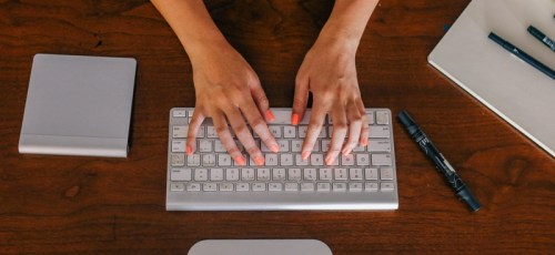 fingers on a mac keyboard