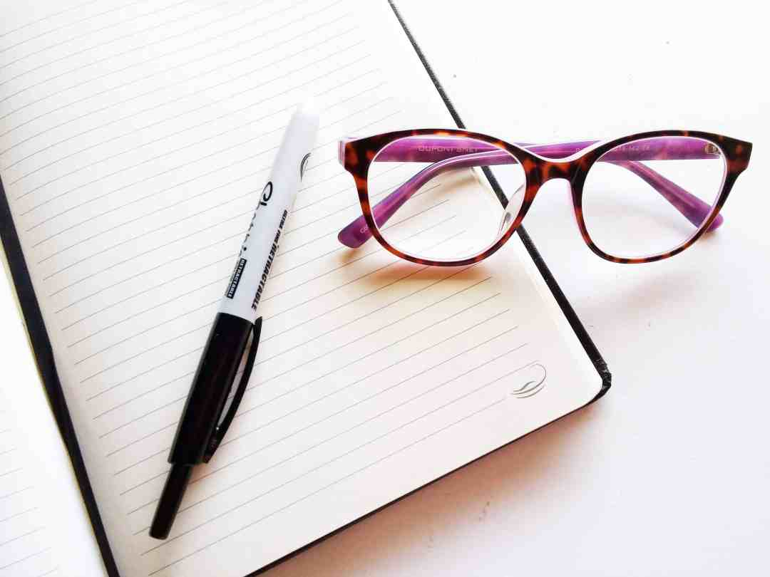Notebook and glasses
