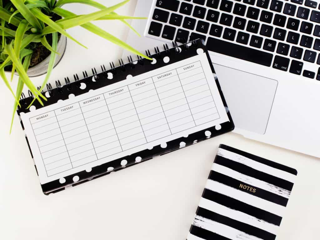Desk with a planner so you can move your career forward