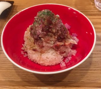 red bowl with Shredded Pork and Beef at tsuta ramen resturant in tokyo