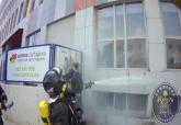 Extinción del incendio de la fachada de la residencia de ancianos Amavir Cartagena