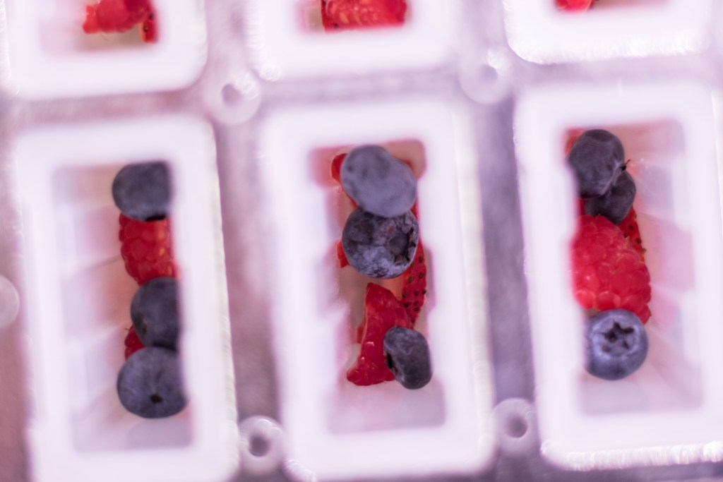 Layer the berries in your popsicle molds for a bit of fruit in every bite!