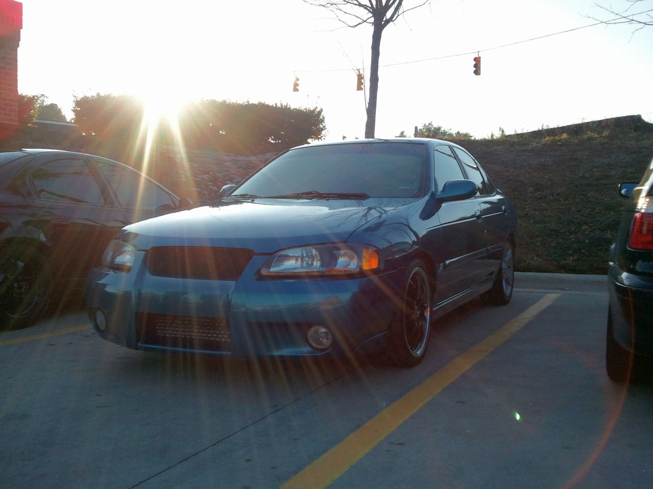 hight resolution of observe it would appear to be a 2002 2003 nissan sentra se r specv with some crappy mismatched wheels bad paint and a horse ton of miles on it