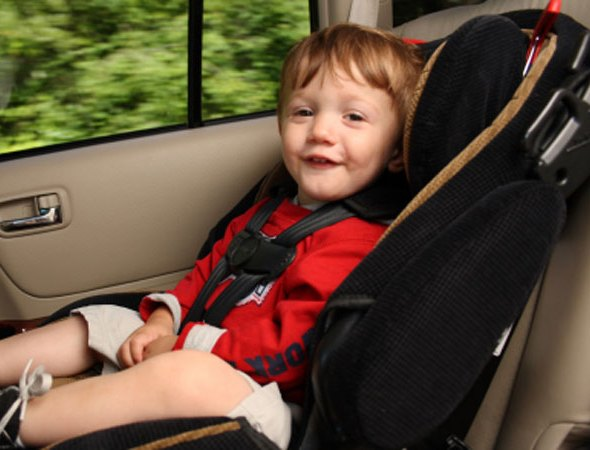 A child sitting in a Child seat designed for him photo