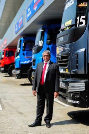 Mr Ravi Pisharody of Tata Motors posing with Tata Prima T1 trucks