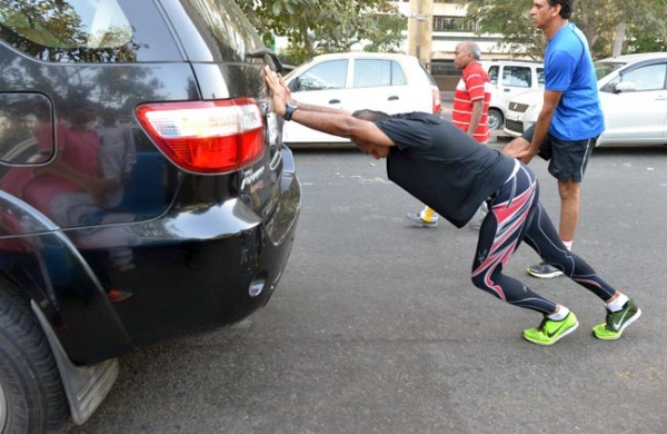 Anil Ambani stretching on his Toyota Fortuner
