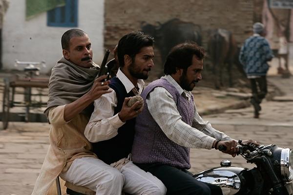 Manoj Bajpai on a Royal Enfield in Gangs of Wasseypur