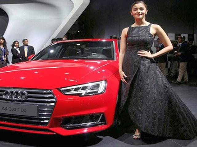 Alia Bhatt with the Audi A4 at the Auto Expo