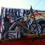"""Make Art, Not War"" Shepard Fairey Paints Town Red"