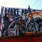 """""""Make Art, Not War"""" Shepard Fairey Paints Town Red"""