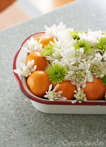 Flowers and produce in vintage pan