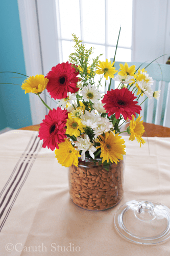 Flowers in almond-filled canister
