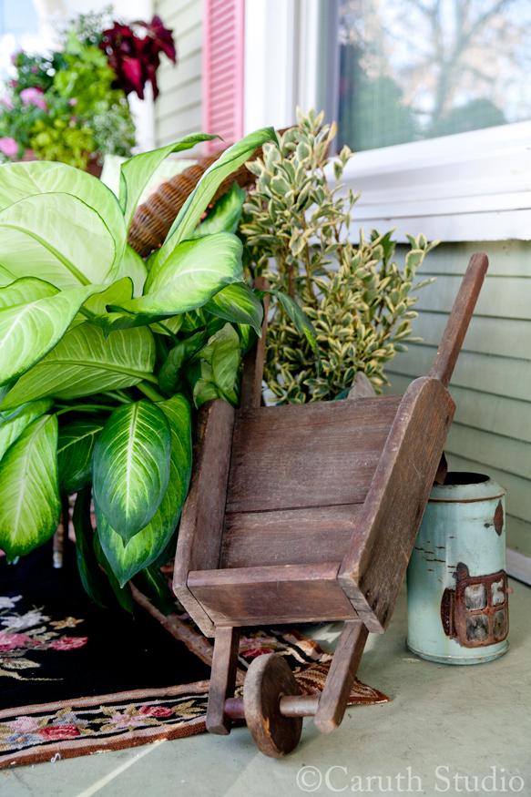 Toy-wheelbarrow-on-porch-makeover