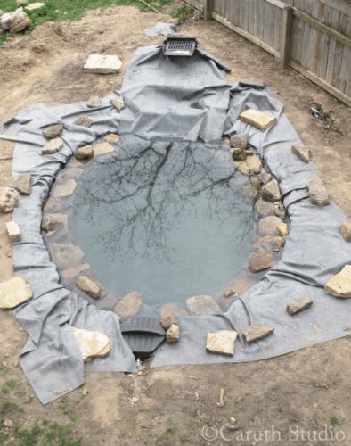 Placing-rocks-around-pond