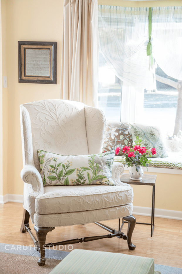 Reupholstered wing chair in white with white raised botanicals
