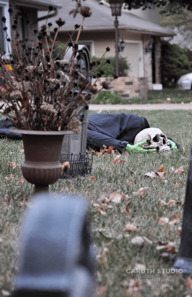 Headless ghoul in graveyard with tombstones and urns