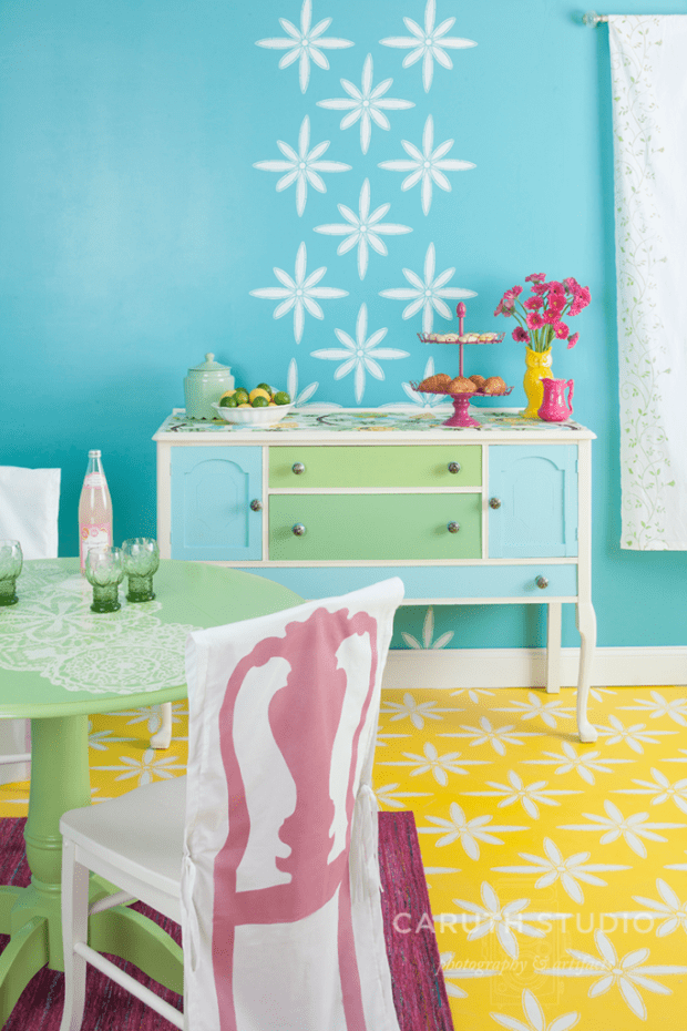 Painted dining room in green, yellow, blue with white stincles