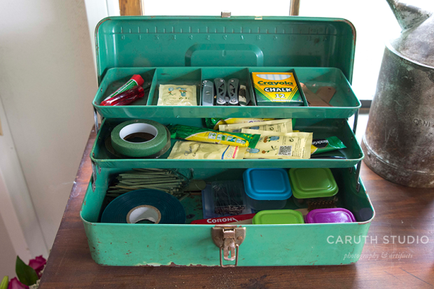 Tackle box full of gardening supplies