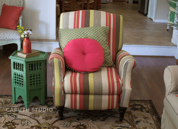armed chair next to hexagon side table