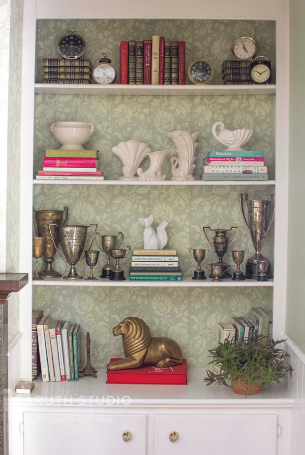 display shelves in front of stenciled wall