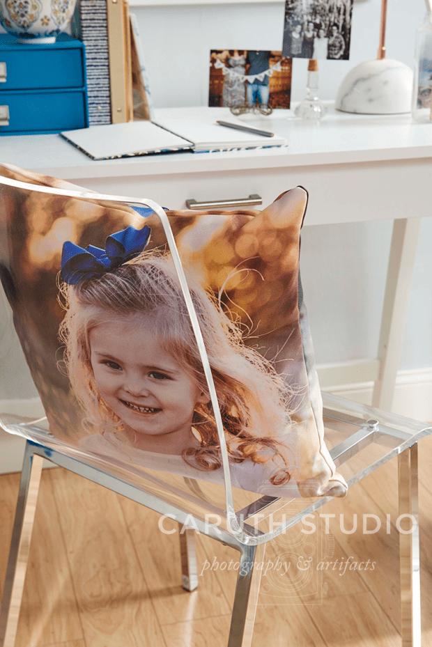 Photo pillow on a clear acrylic chair