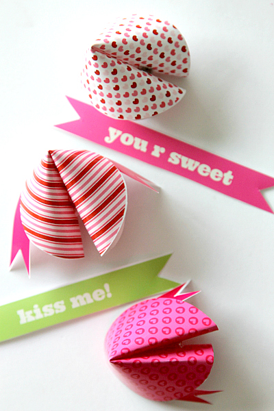 mini fortunes that read kiss me and you are sweet with paper fortune cookies