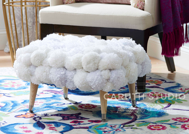 Pom-pom covered footstool