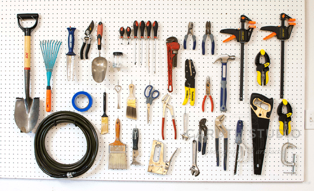 white tool pegboard with hanging tools