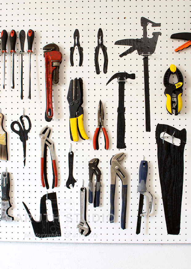 process of removing tools and placing tool silhouettes to the pegboard