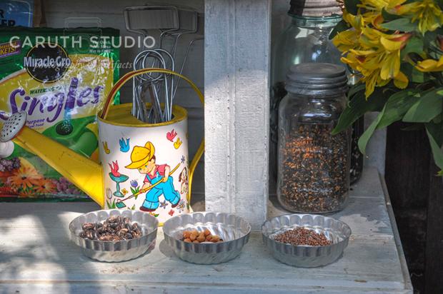storage shelf with bird seed and potting mix