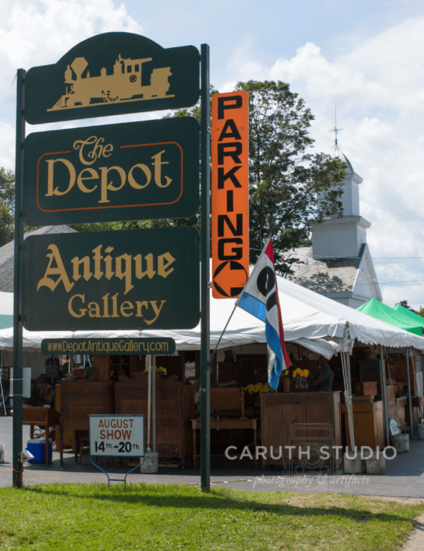 sign for parking and the antique gallery and depot at Madison Bouckville Antique Week