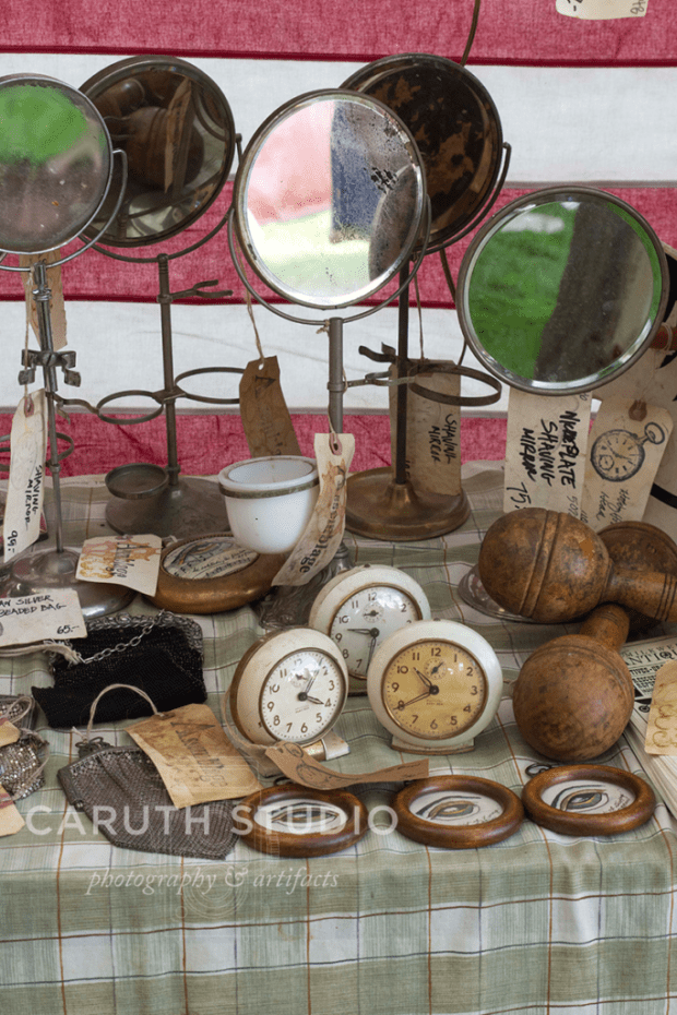 assortment of vintage clocks and mirrors at madison bouckville antique week